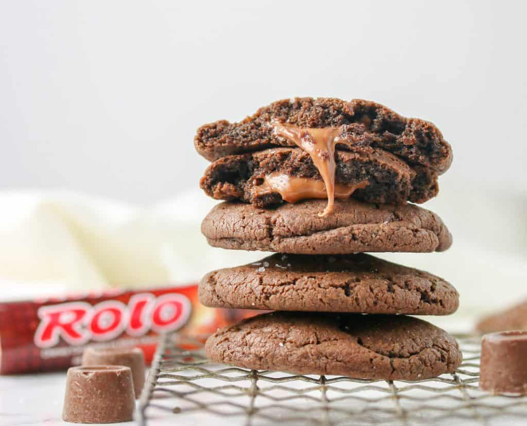 chocolat rolo cookies stacked on a cooling rack