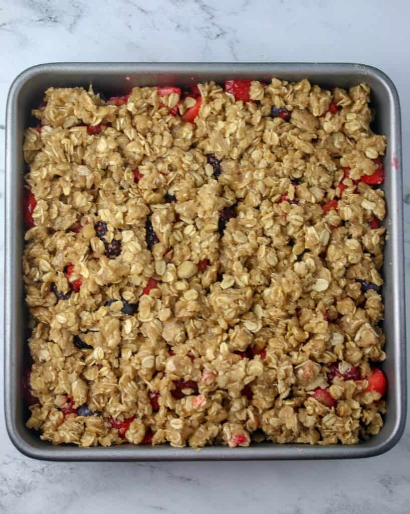 pan of berry crisp ready to be baked