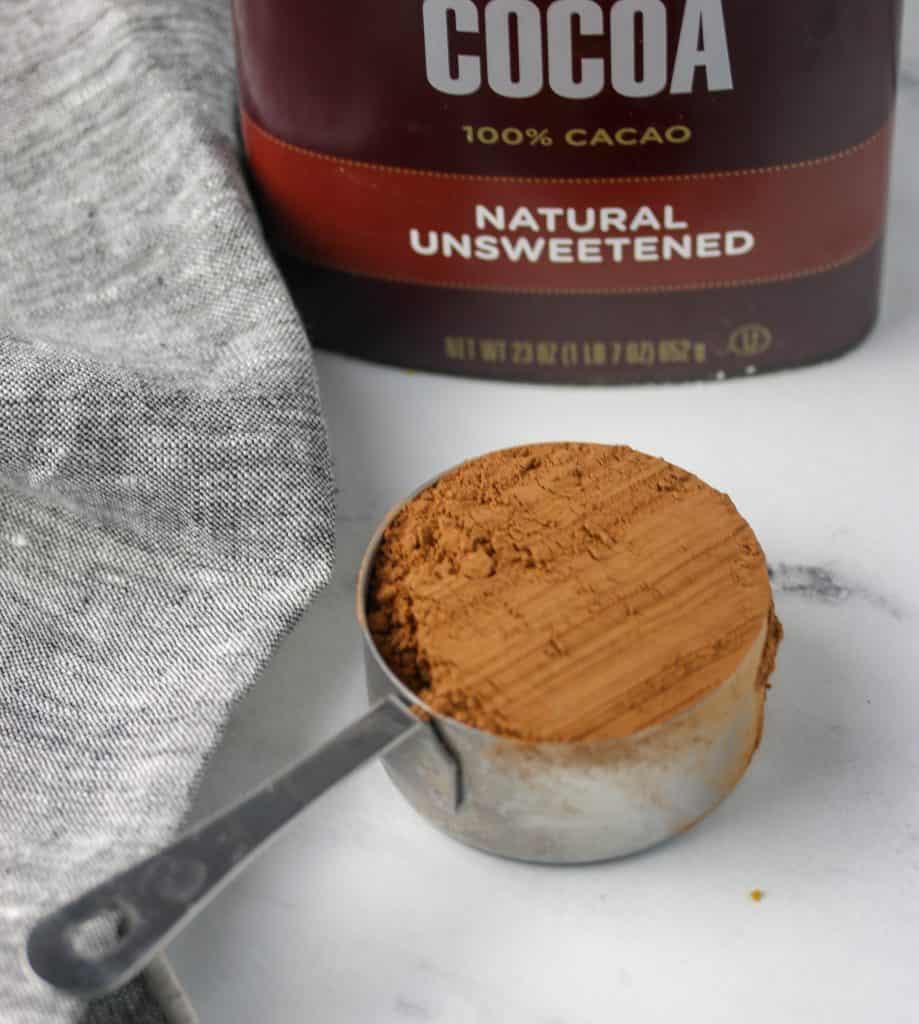 measuring cup of cocoa powder