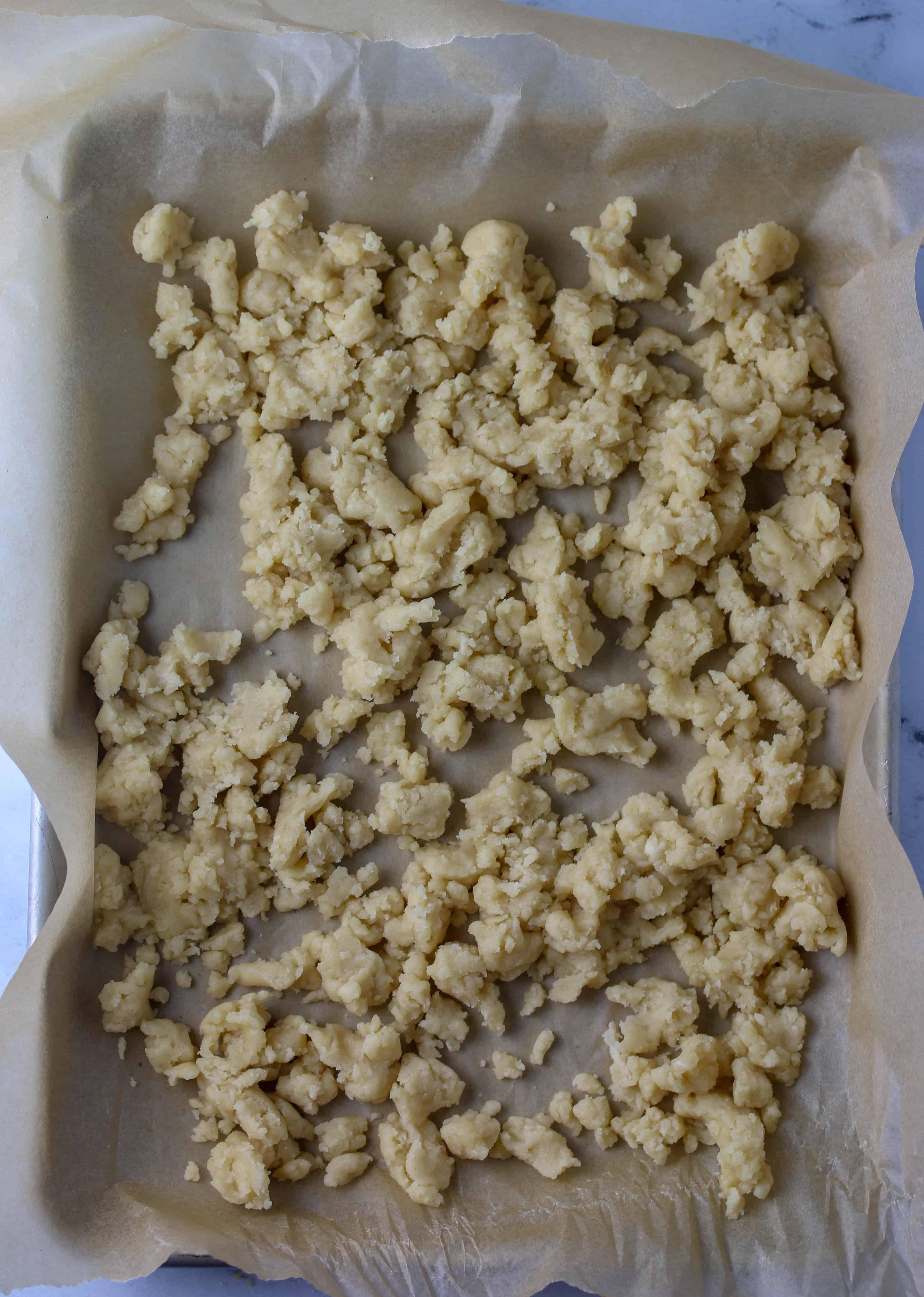 pie crumbs on a half baking sheet