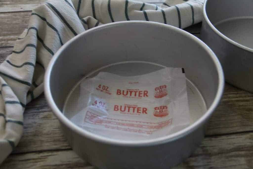 butter wrapper inside a cake pan to grease it