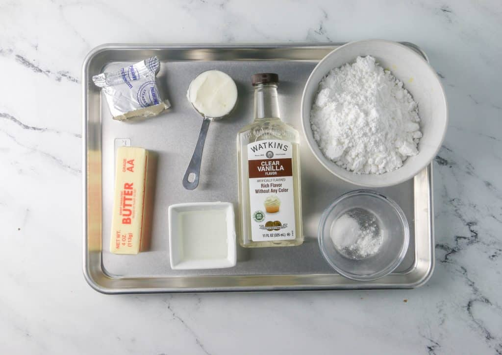 milk bar cake frosting ingredients on a sheet pan