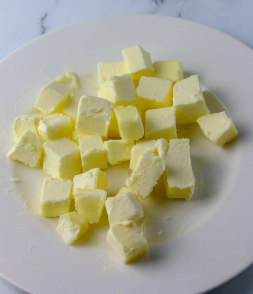 butter cut into cubes on a plate