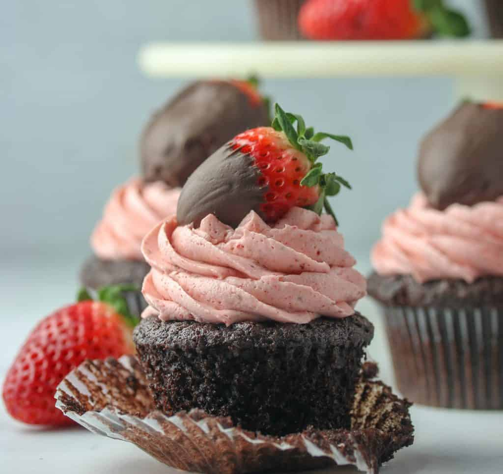 chocolate strawberry cupcake topped with a chocolate covered strawberry