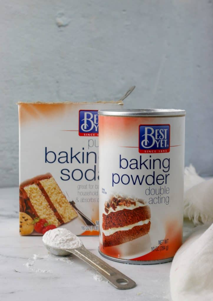 baking powder can and a box of baking soda