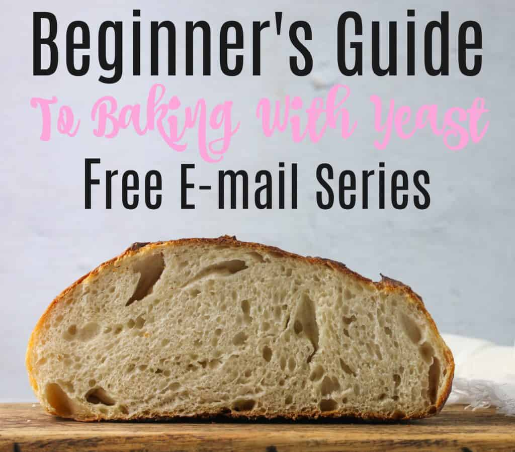 """loaf of bread cut in half with text above that reads """" beginner's guide to baking with yeast free e-mail series"""""""