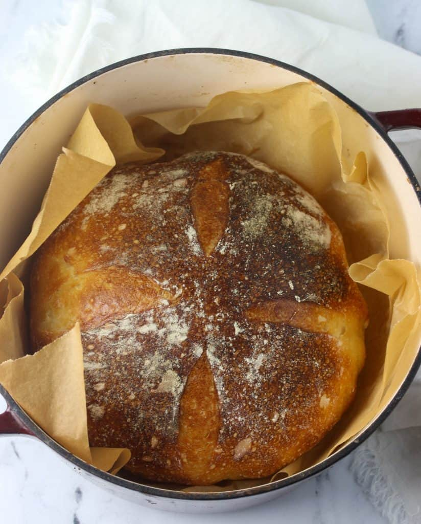 baked sourdough bread loaf in a dutch oven