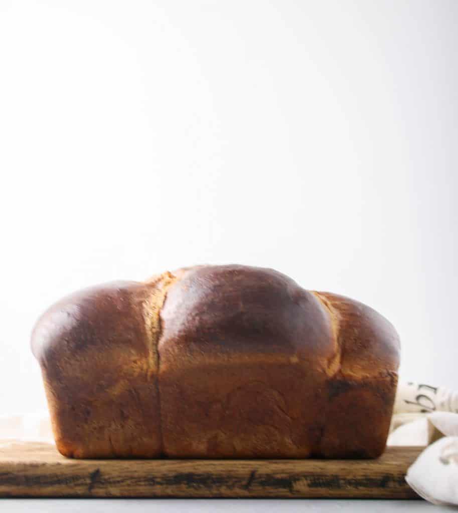 loaf of brioche bread on a cutting board