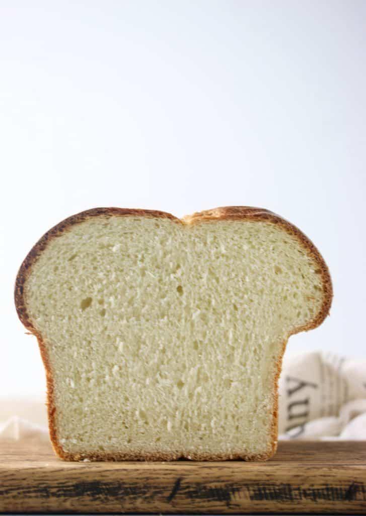 loaf of brioche bread cut in half