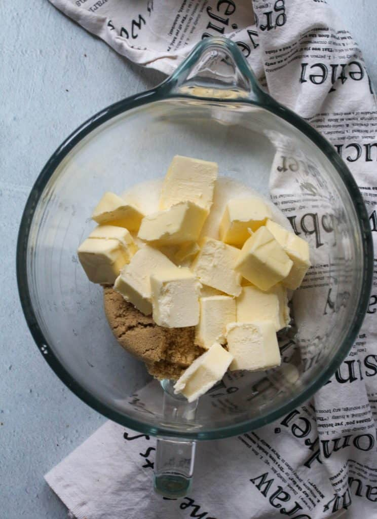 butter and sugars in a glass bowl