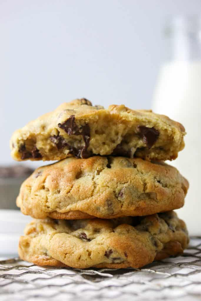three Levain bakery chocolate chip cookies stacked on top of each other