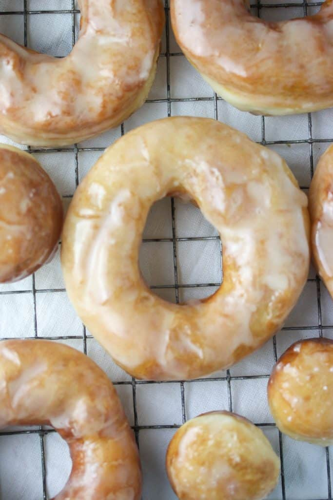 Glazed Yeast Donuts on a cooling rack
