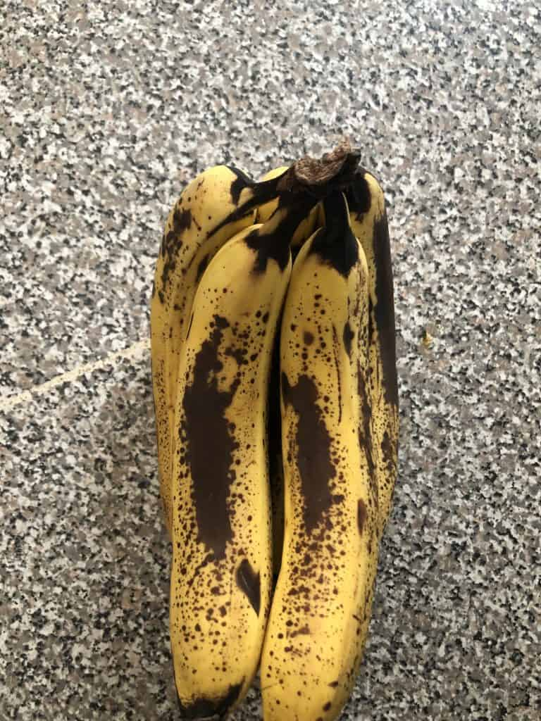ripe bananas that are have very large black speckled spots