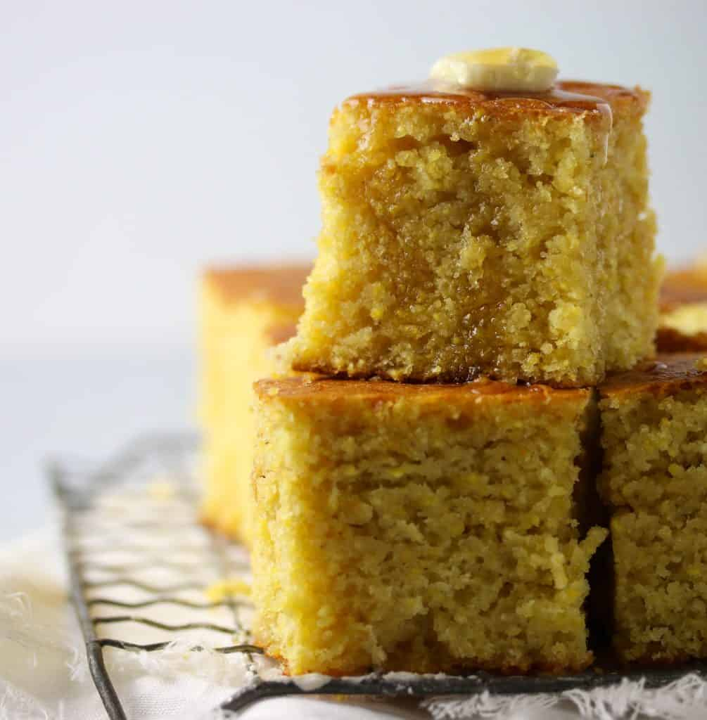 two slices of cornbread stacked on a cooling rack