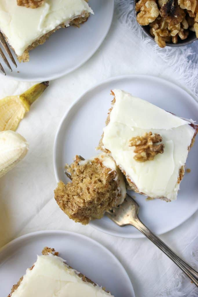 banana cake slice on a plate with a fork