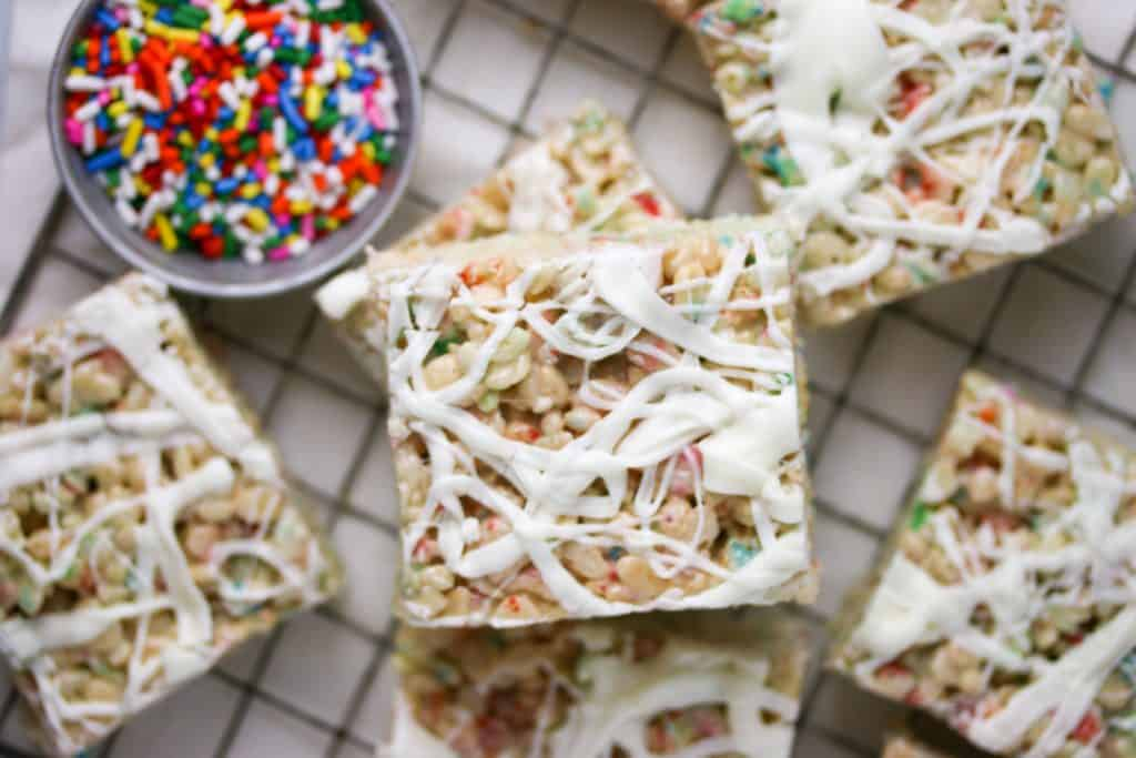 white chocolate funfetti rice krispie treats on a cutting board