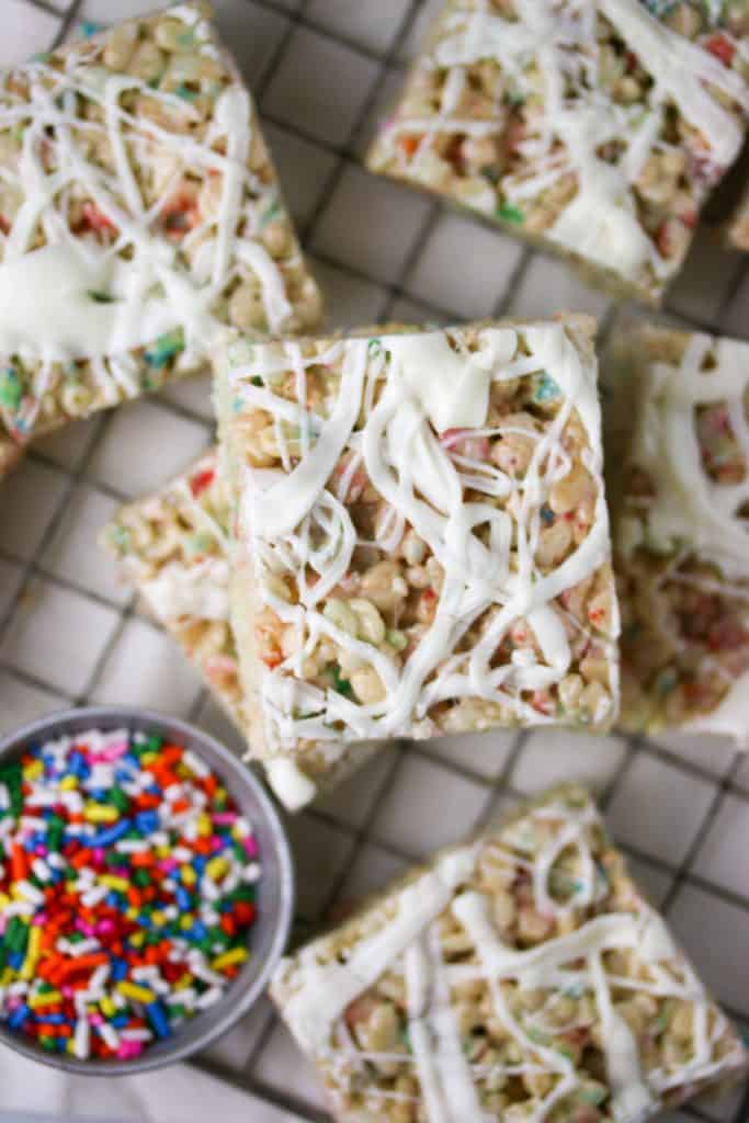 white chocolate funfetti rice krispie treats on a cooling rack