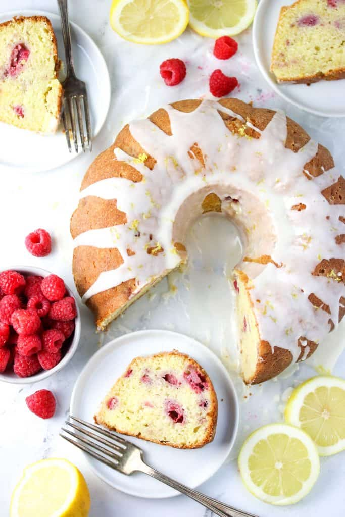lemon raspberry bundt cake and a few slices on plates