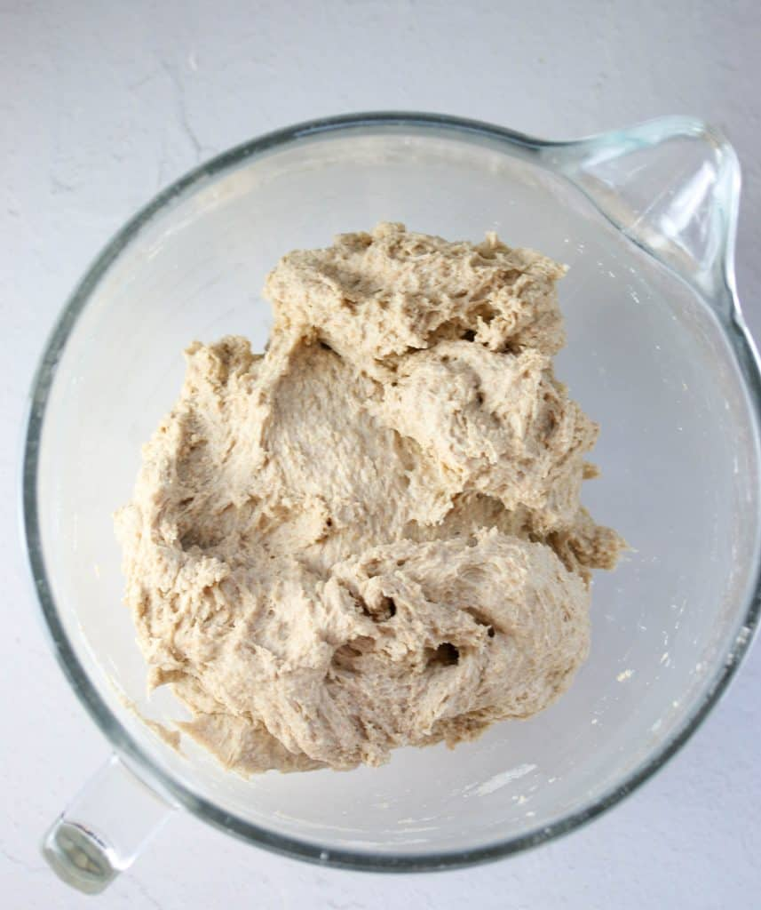 whole wheat sandwich bread dough in a mixing bowl