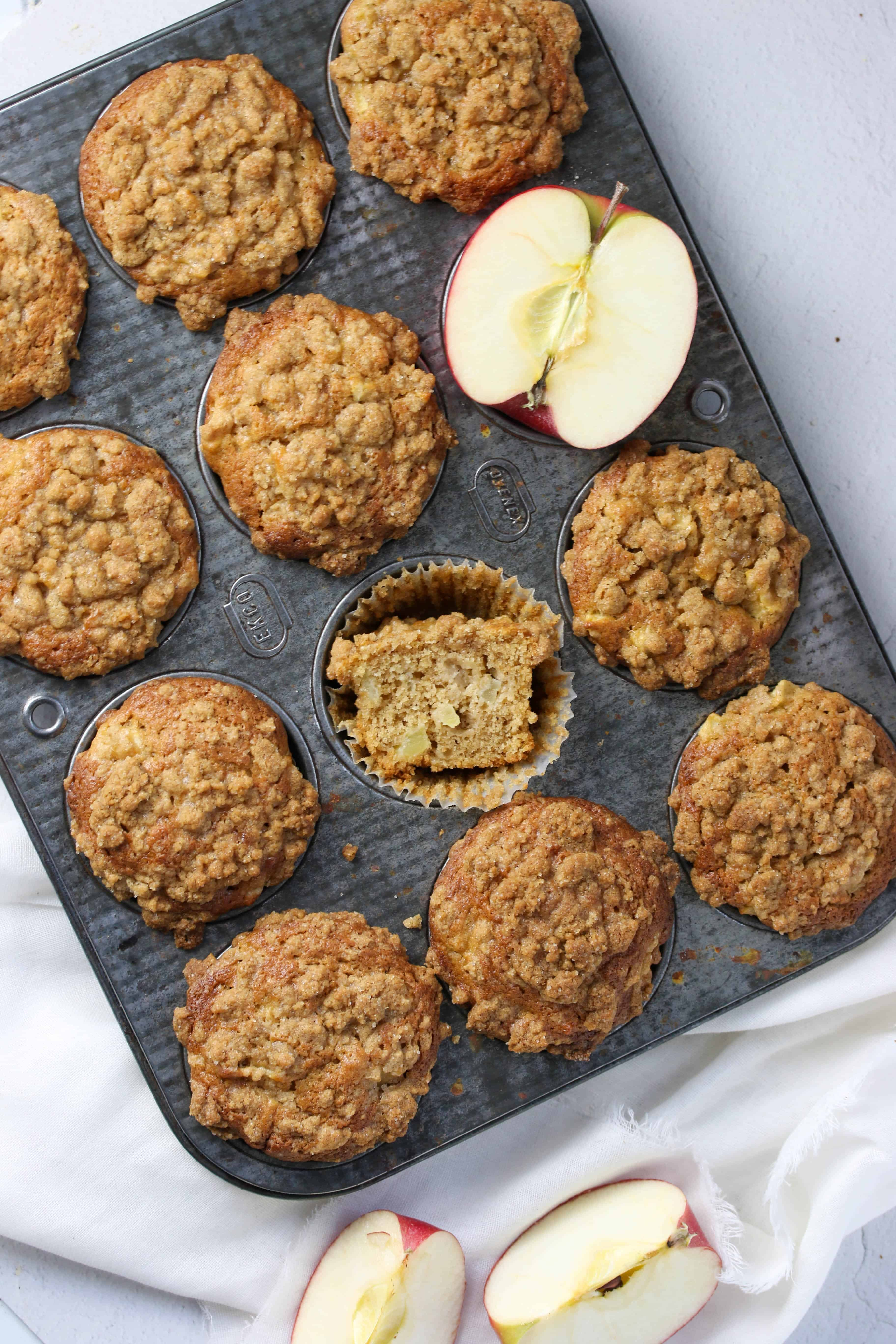 baked apple crumb muffins in muffin tin