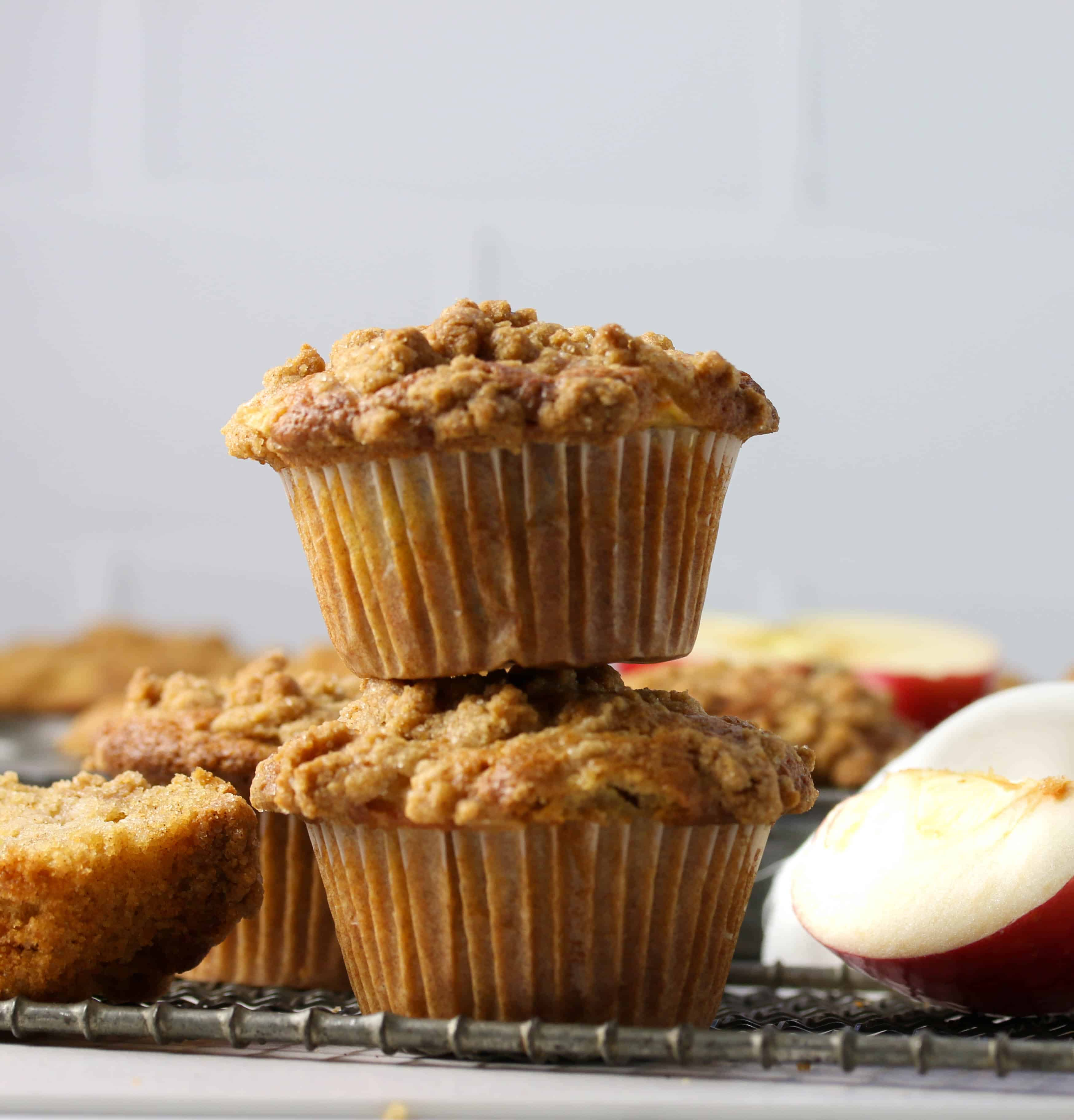 two baked apple crumb muffins stacked on top of each other