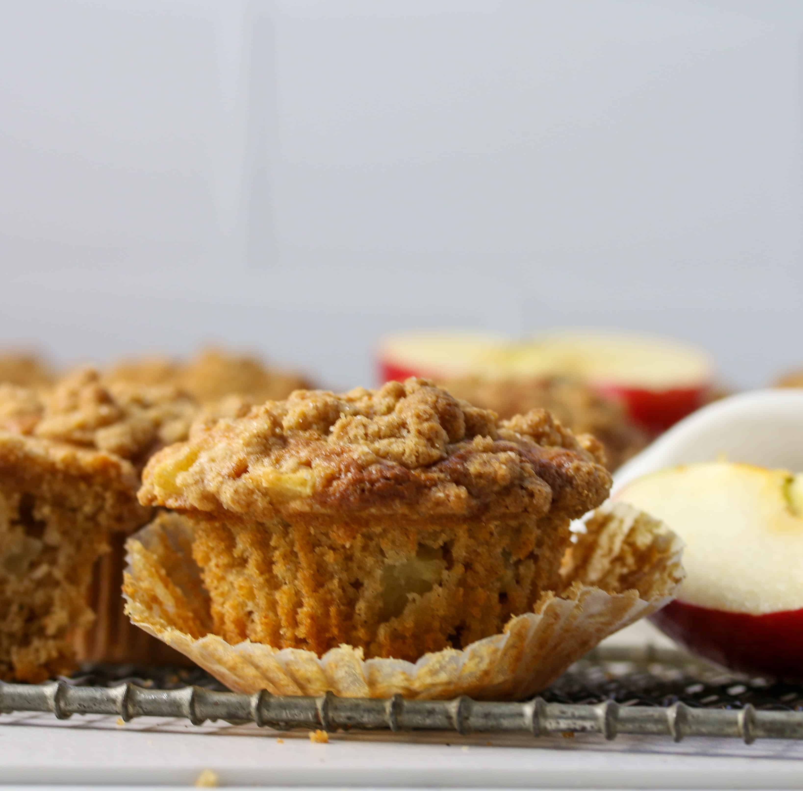 apple crumb muffin with liner peeled back