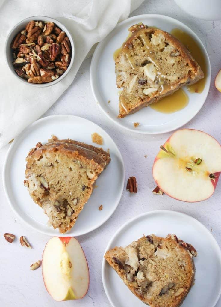 three slices of apple dapple cake on plates