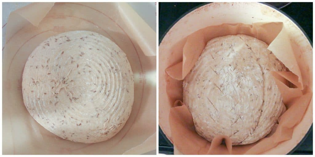 bread proofed and in dutch oven with a slash down the middle