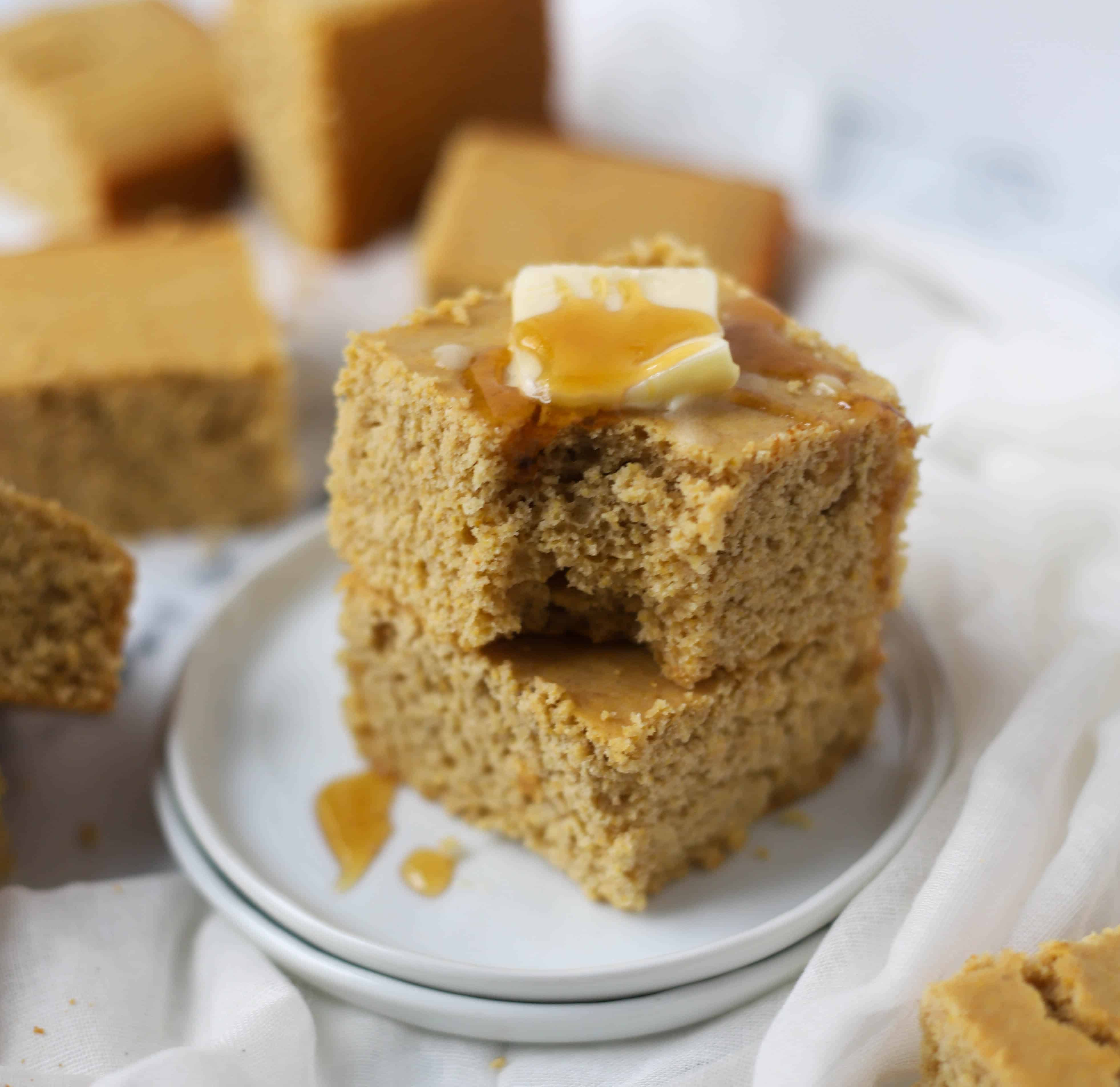 healthy cornbread slice topped with butter and honey