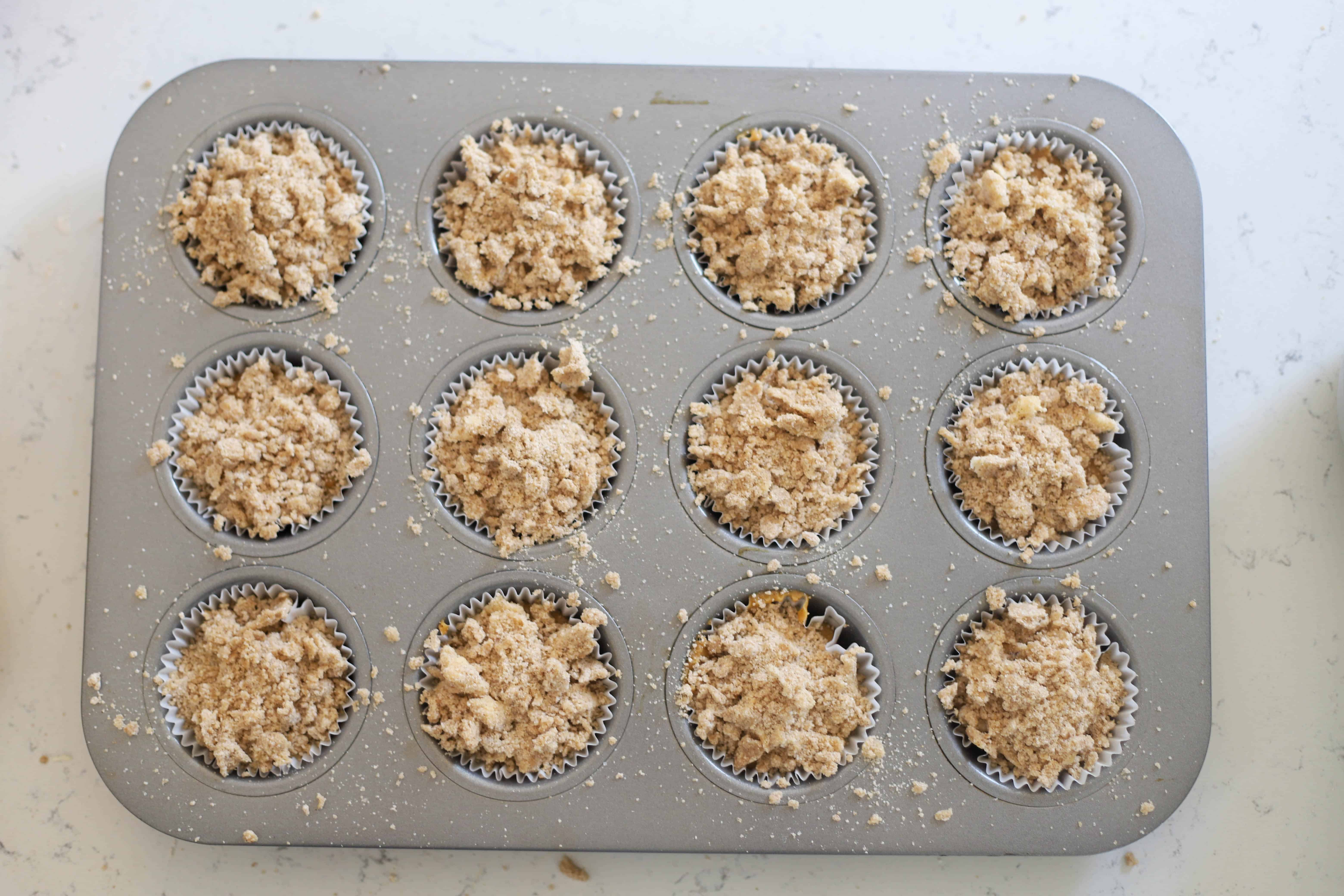 streusel sprinkled on top of muffins