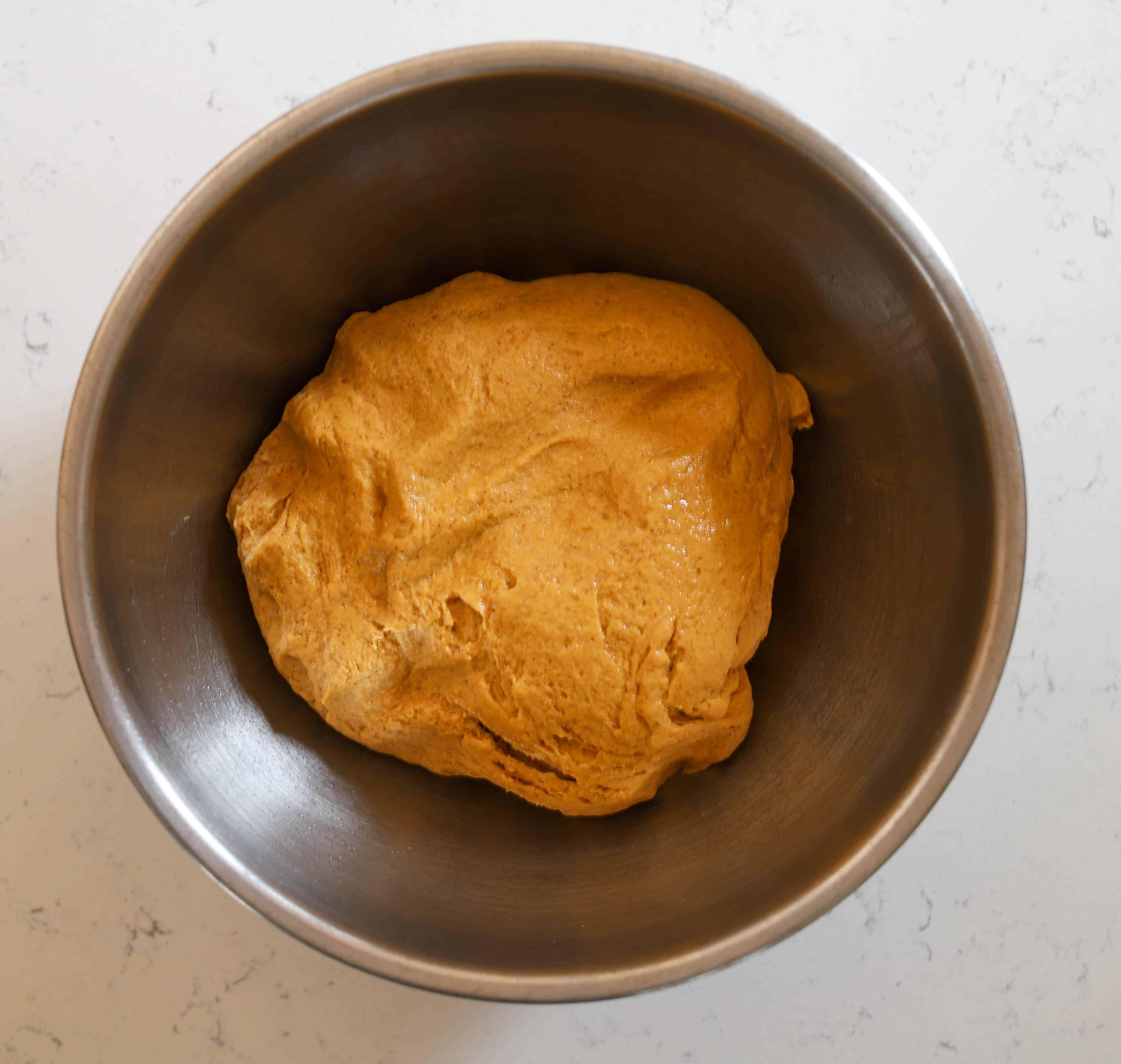 pumpkin dough in a metal bowl