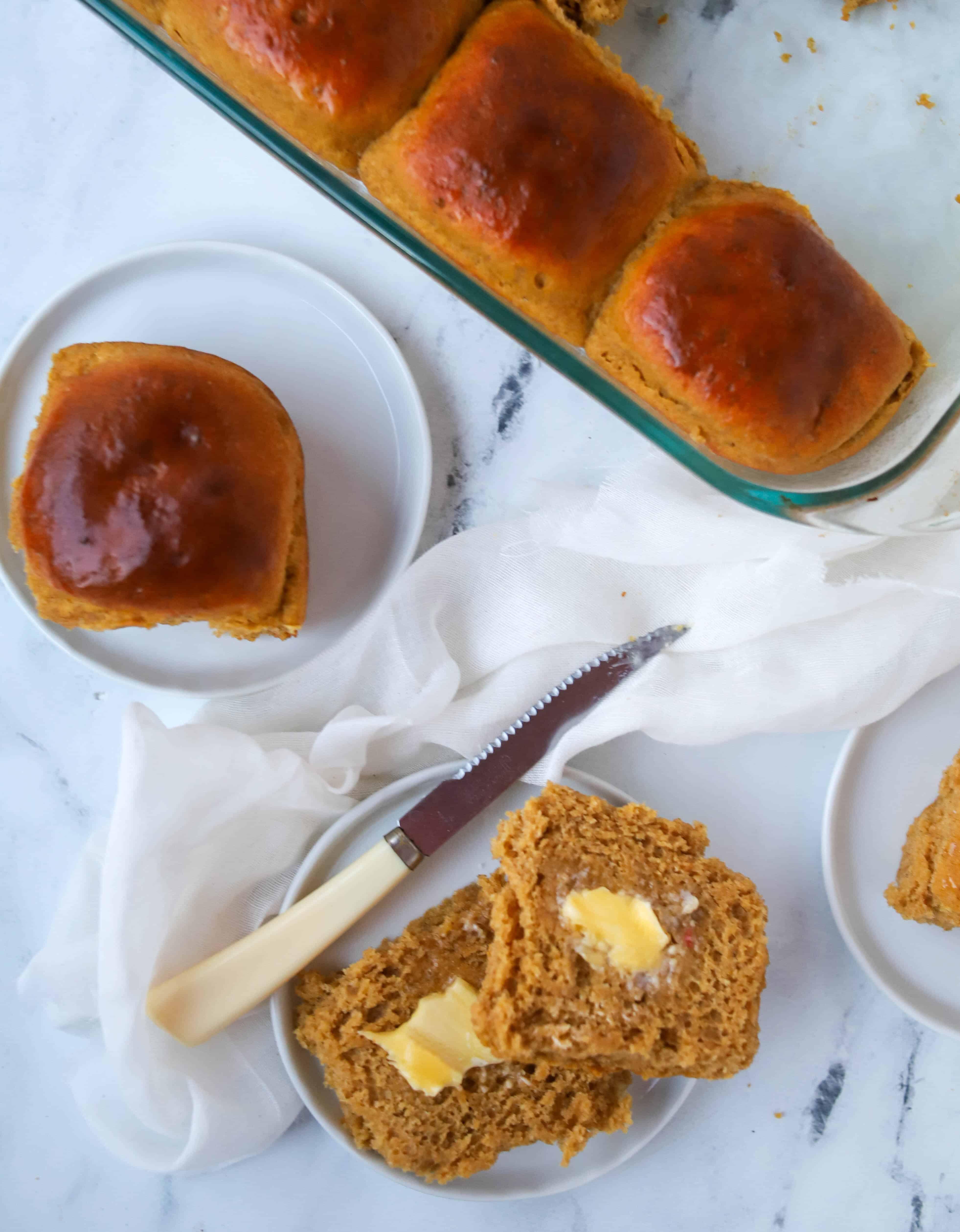 pumpkin roll split in half and buttered