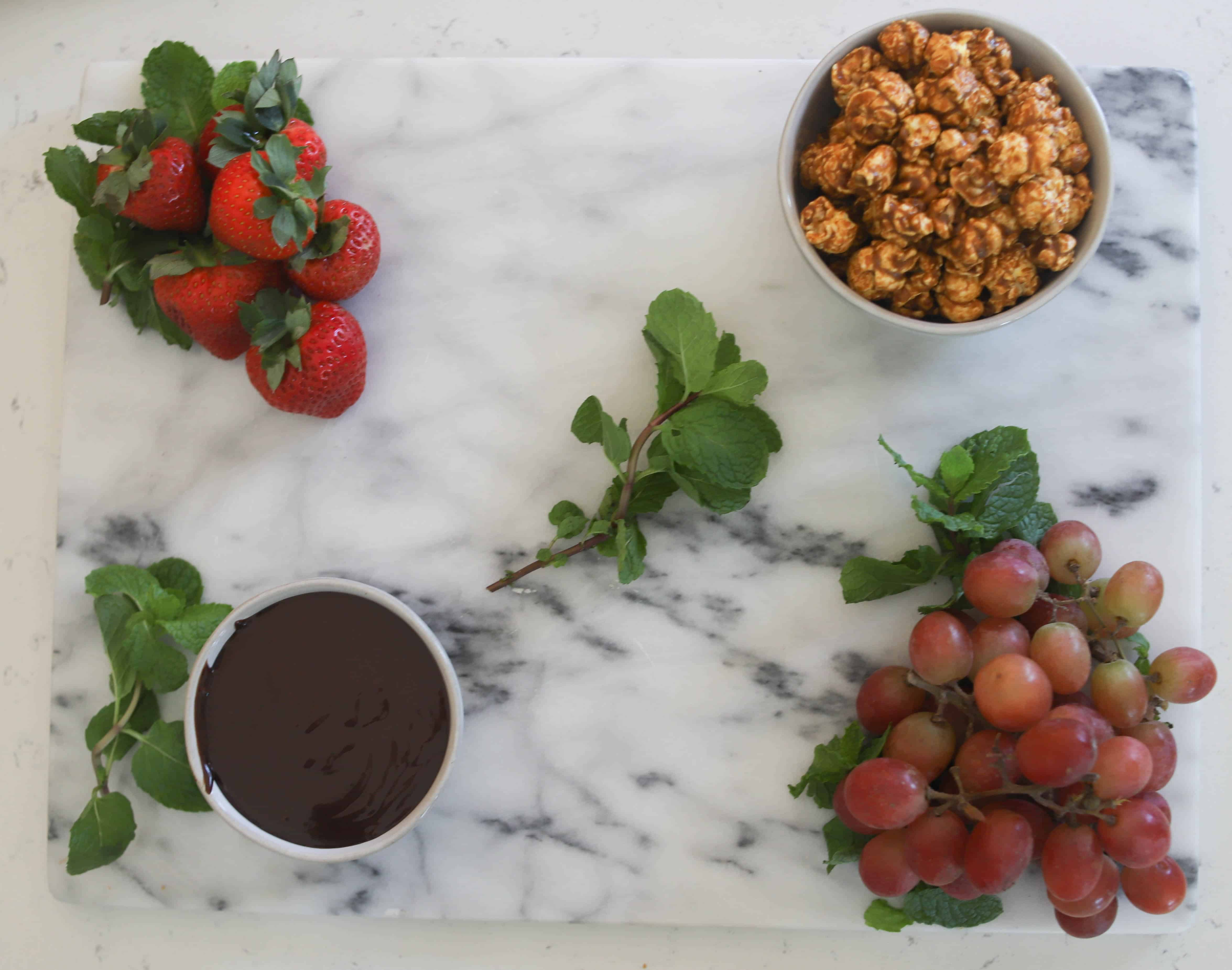 bowls and fruit on marble board