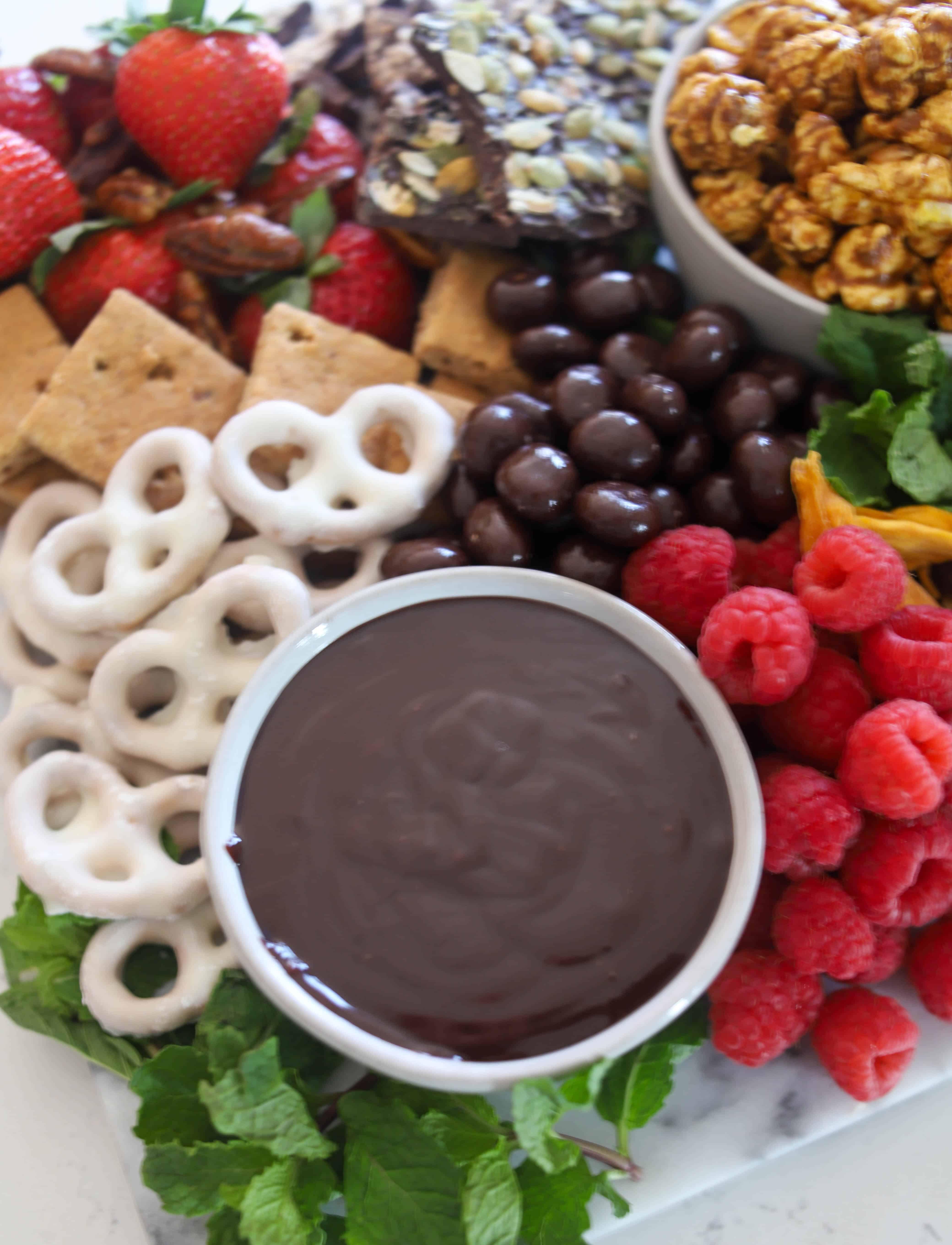 close up of chocolate ganache on dessert board