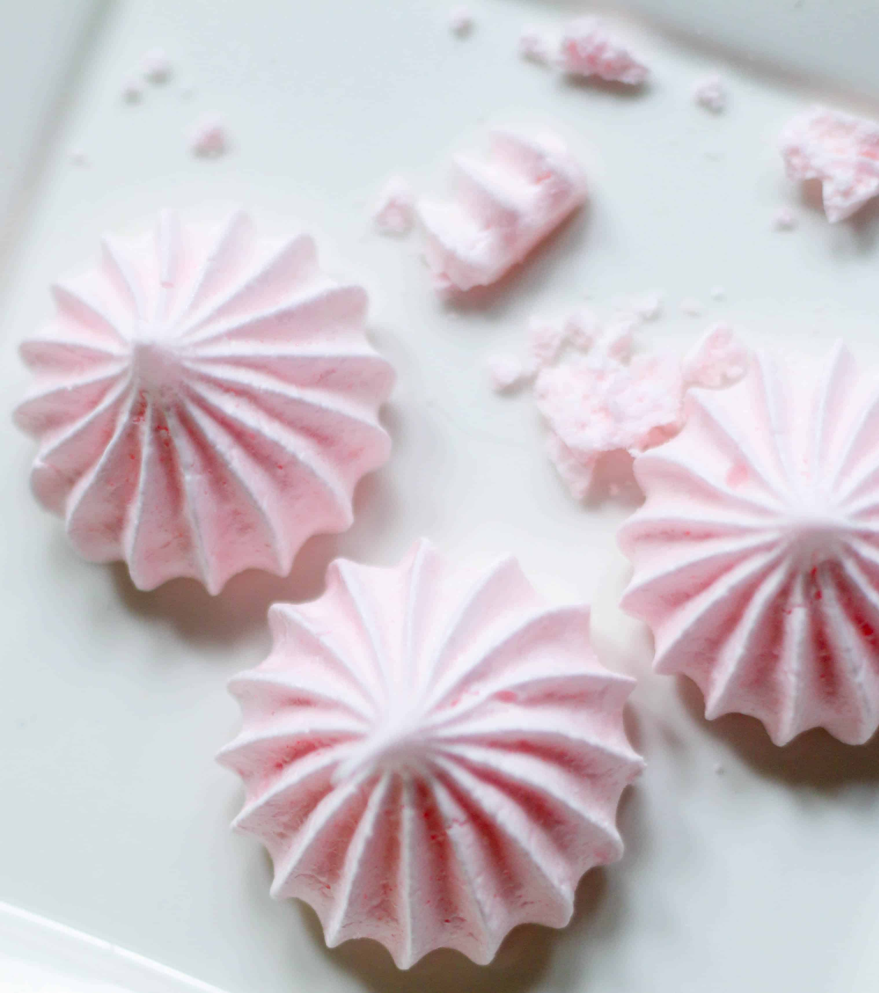 three peppermint meringues on a plate