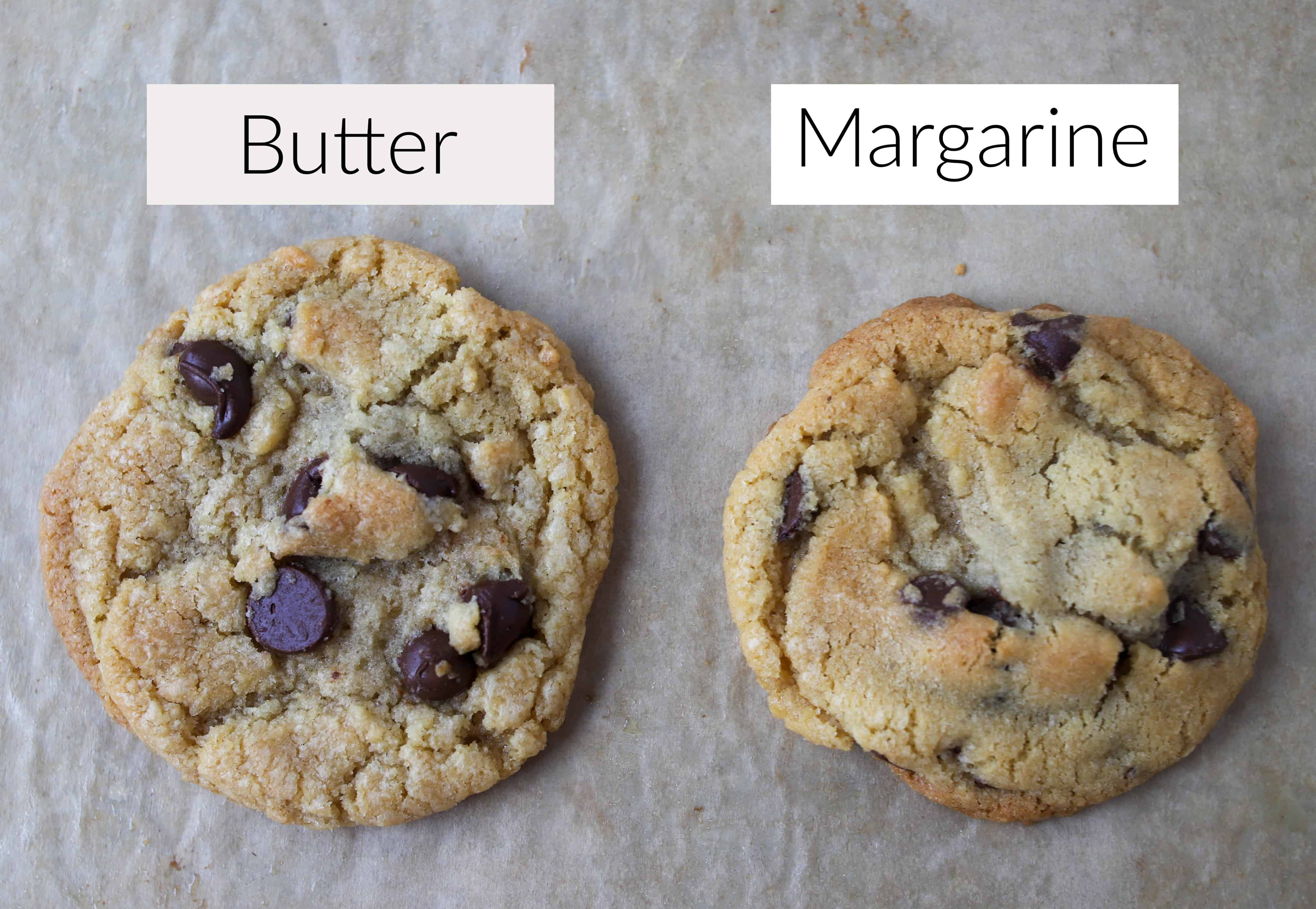 two chocolate chip cookies, one made with butter and one made with margarine