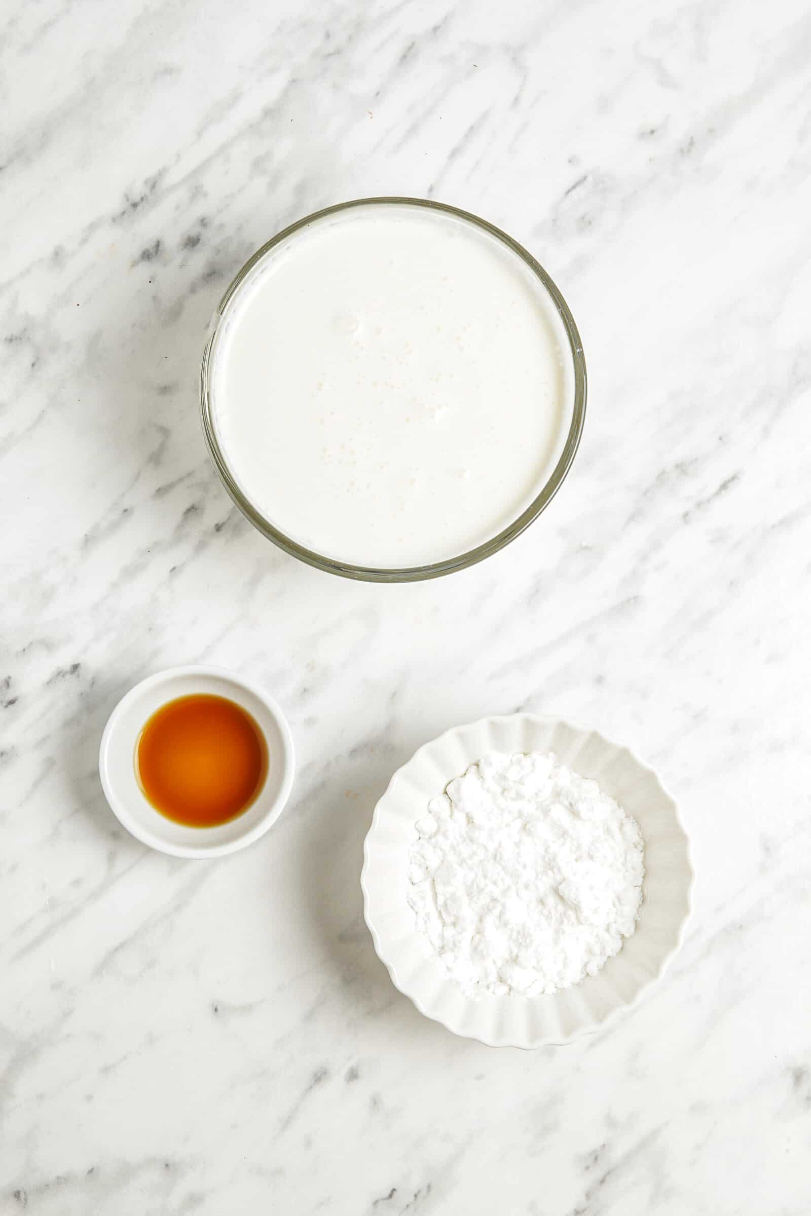 ingredients for whipped cream prepped in small bowls