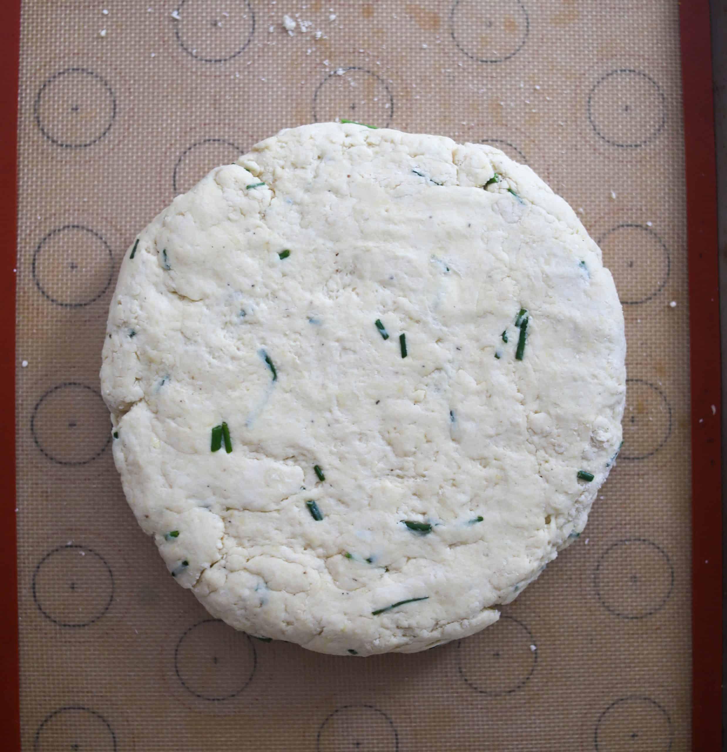 cheddar Irish soda bread dough shaped into a round on a baking sheet