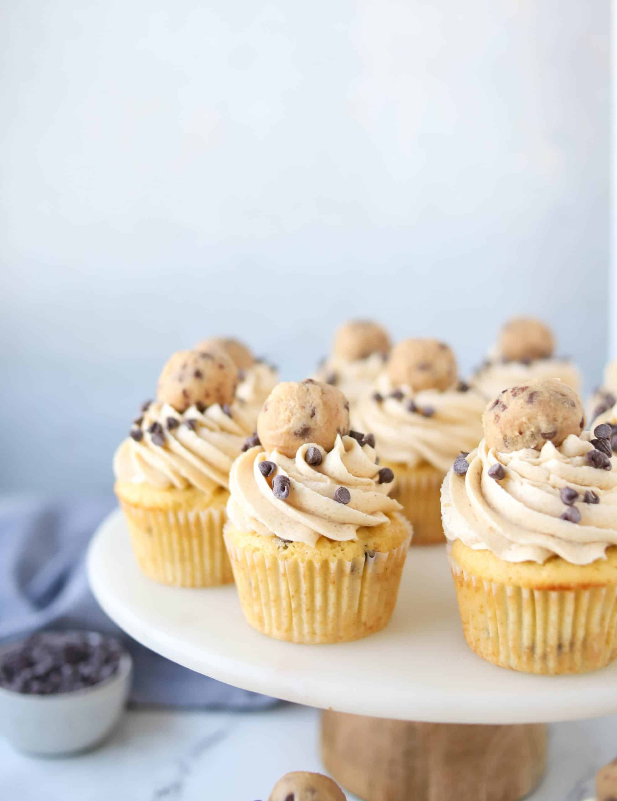 cookie dough cupcakes on a cake stand