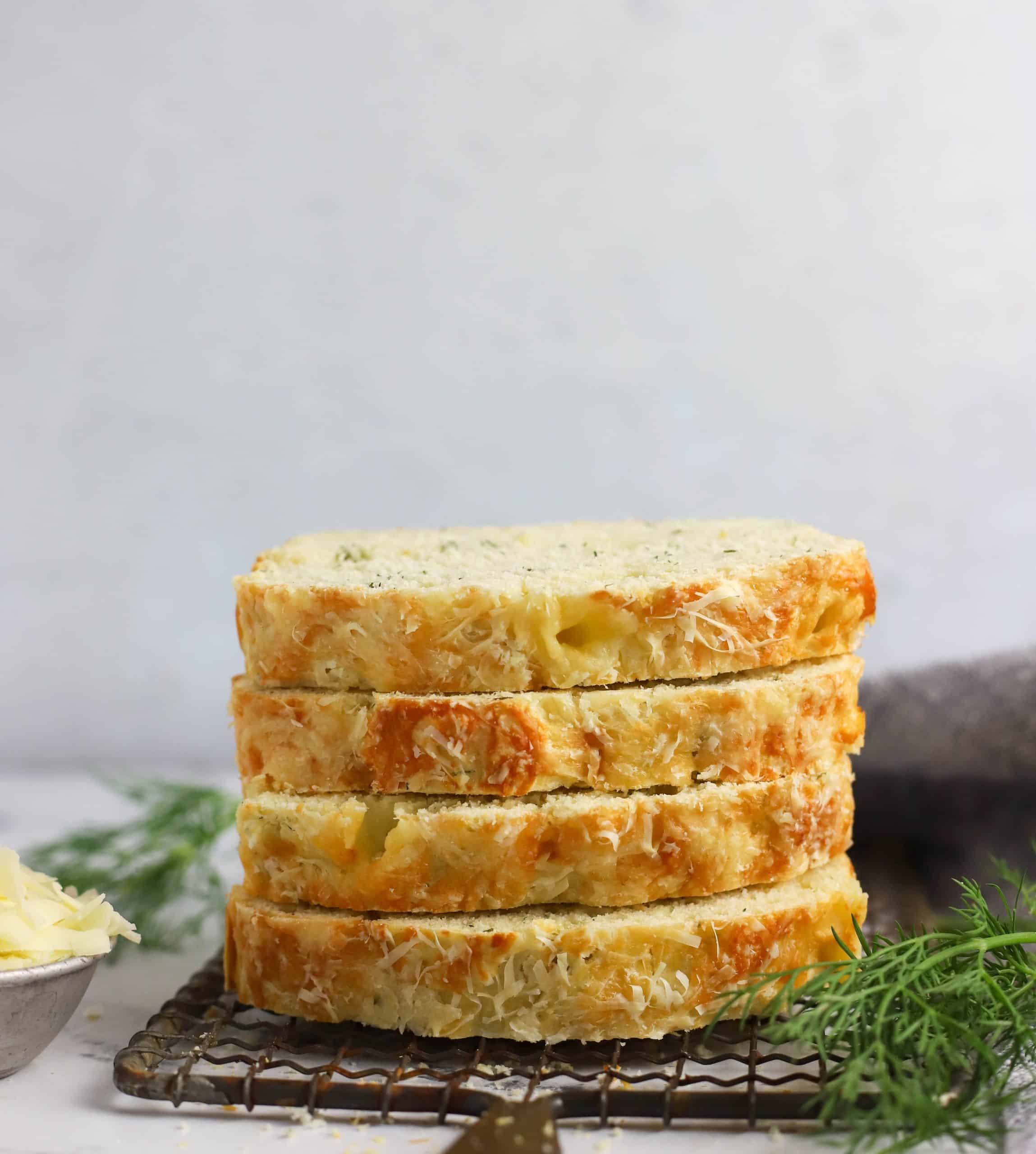 four slices of dill bread stacked on top of each other