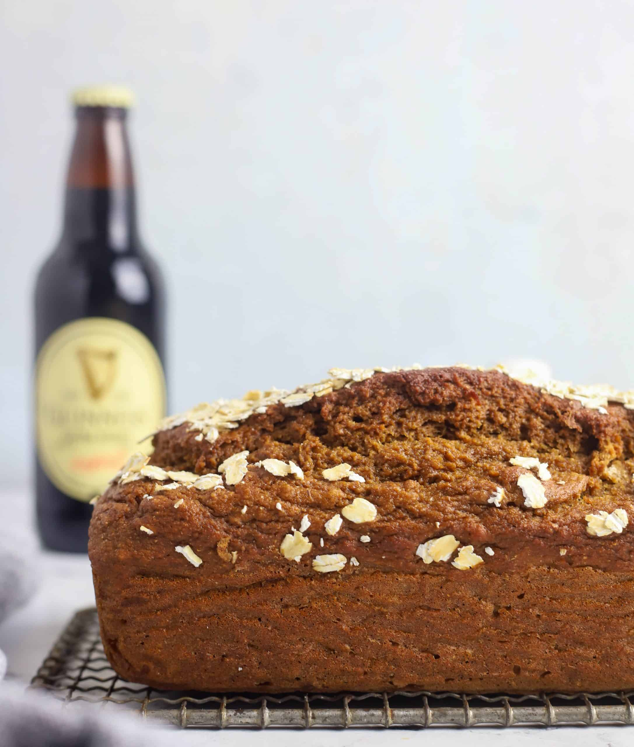 whole Guinness bread loaf and a bottle of Guinness beer
