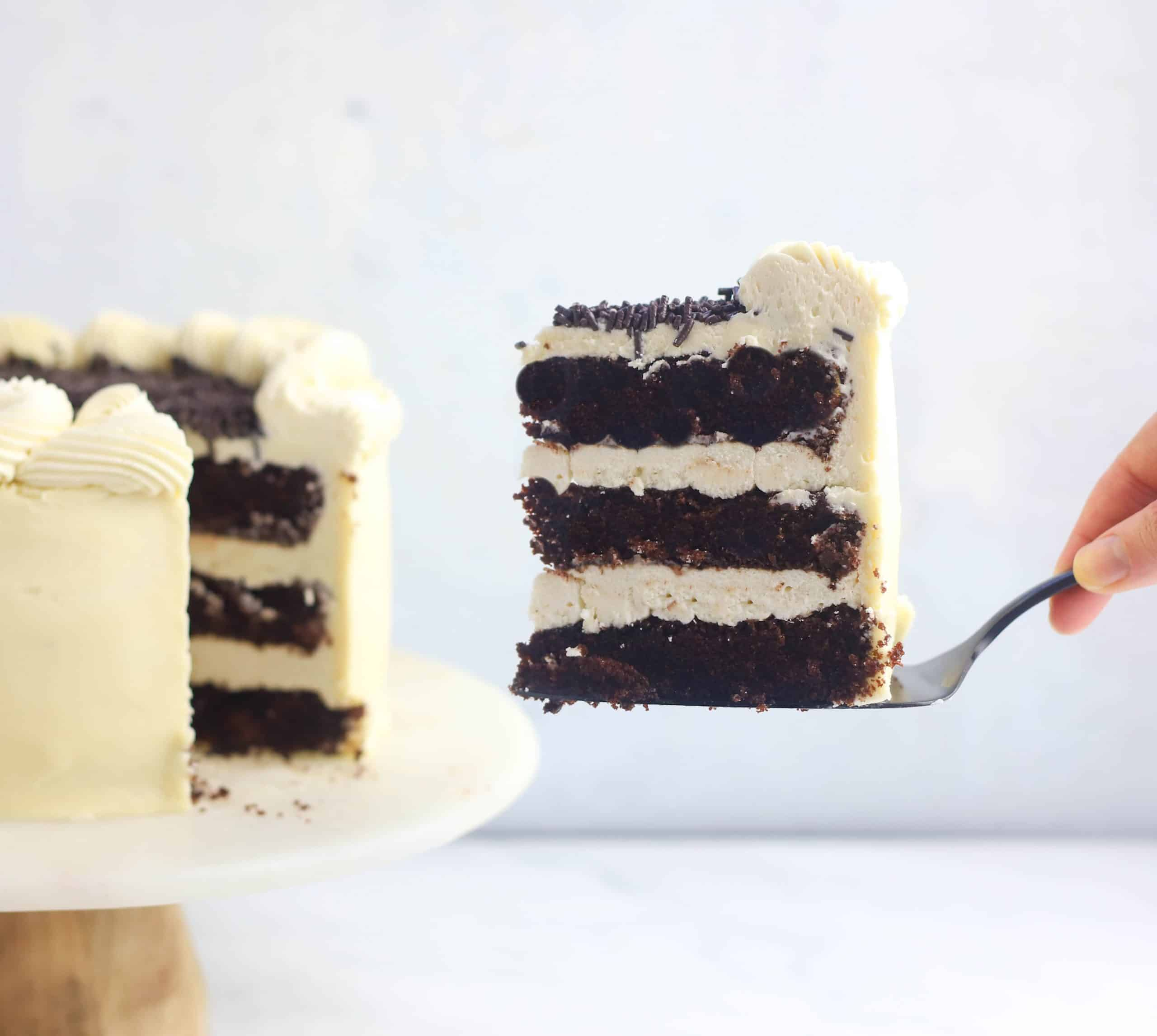 slice of Guinness cake being cut and removed on a cake server