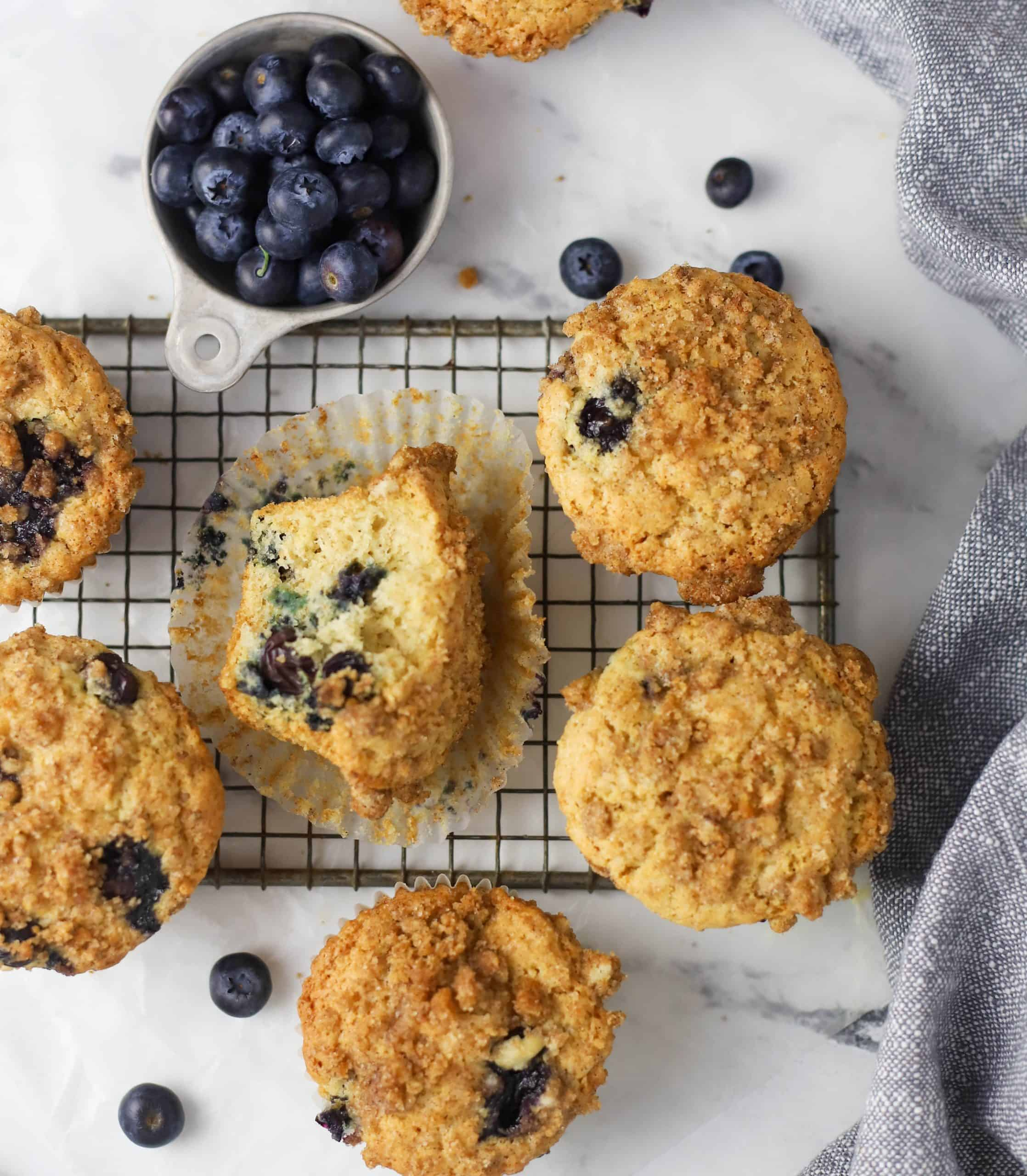 sourdough blueberry muffins on a cooling rack
