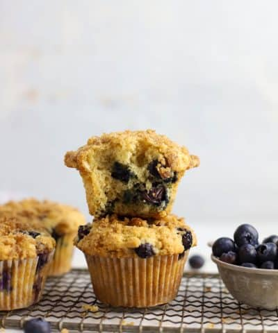 two sourdough blueberry muffins stacked on top of each other
