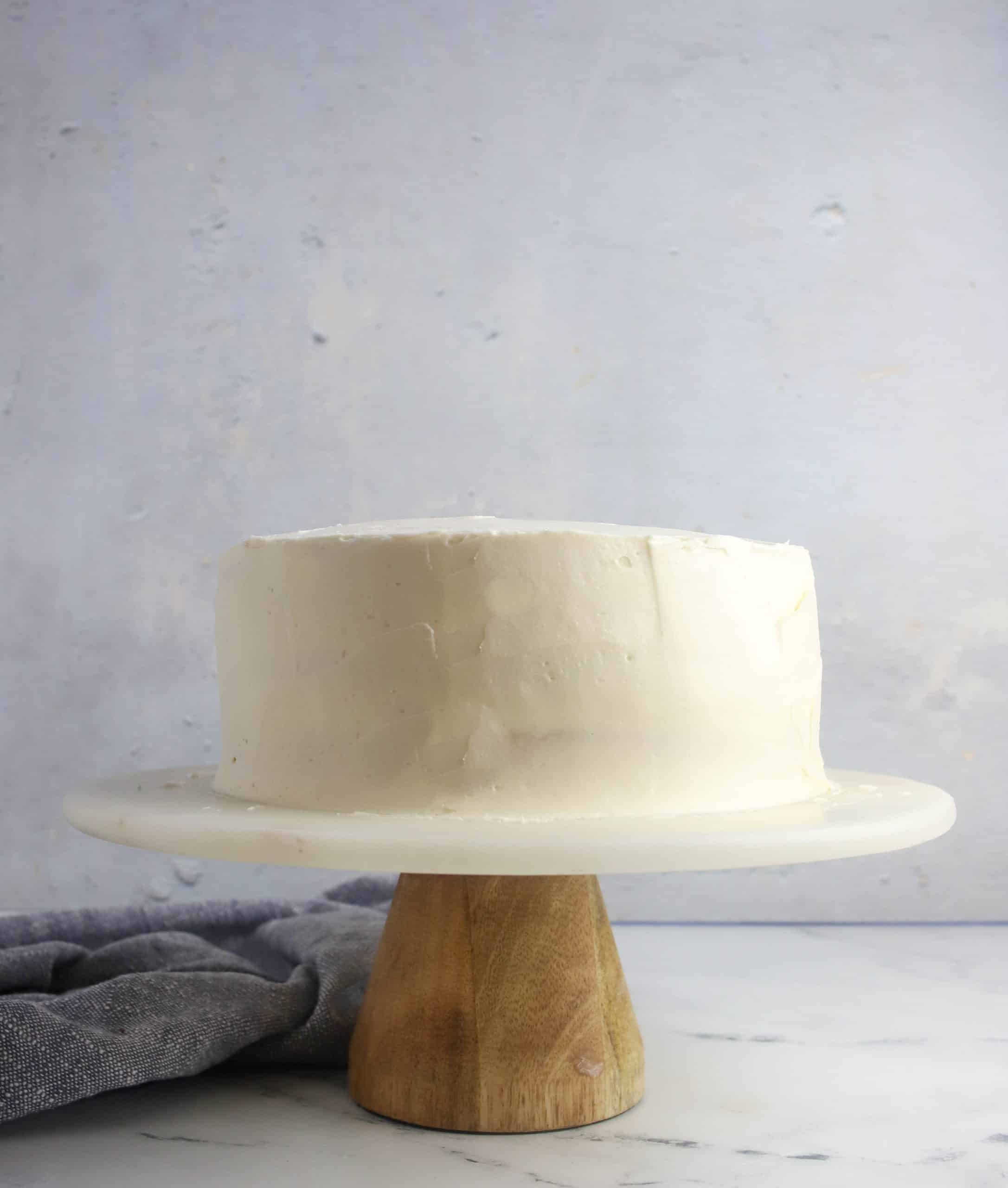 frosted layer cake on a cake stand