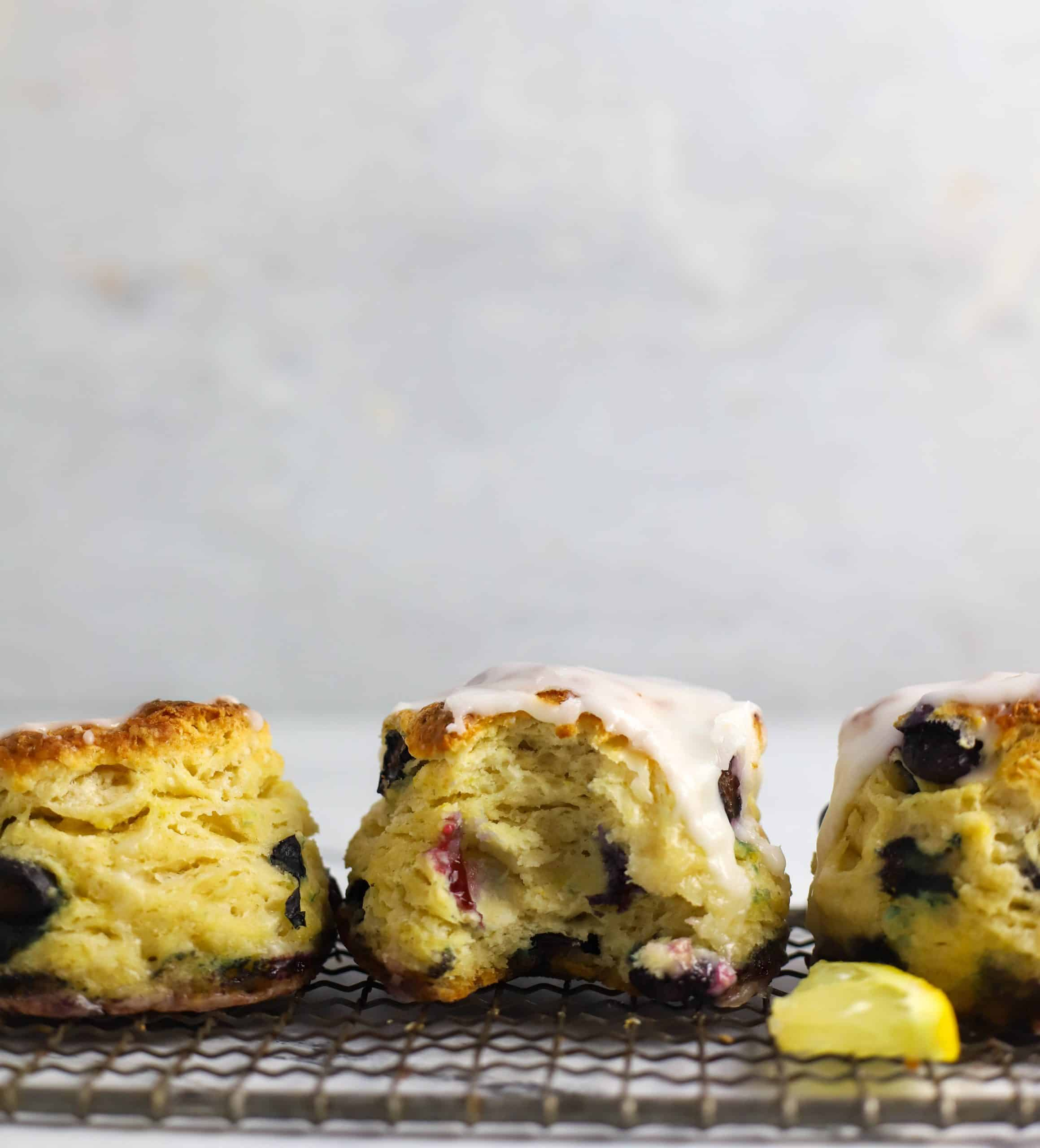 three blueberry biscuits on a cooling rack