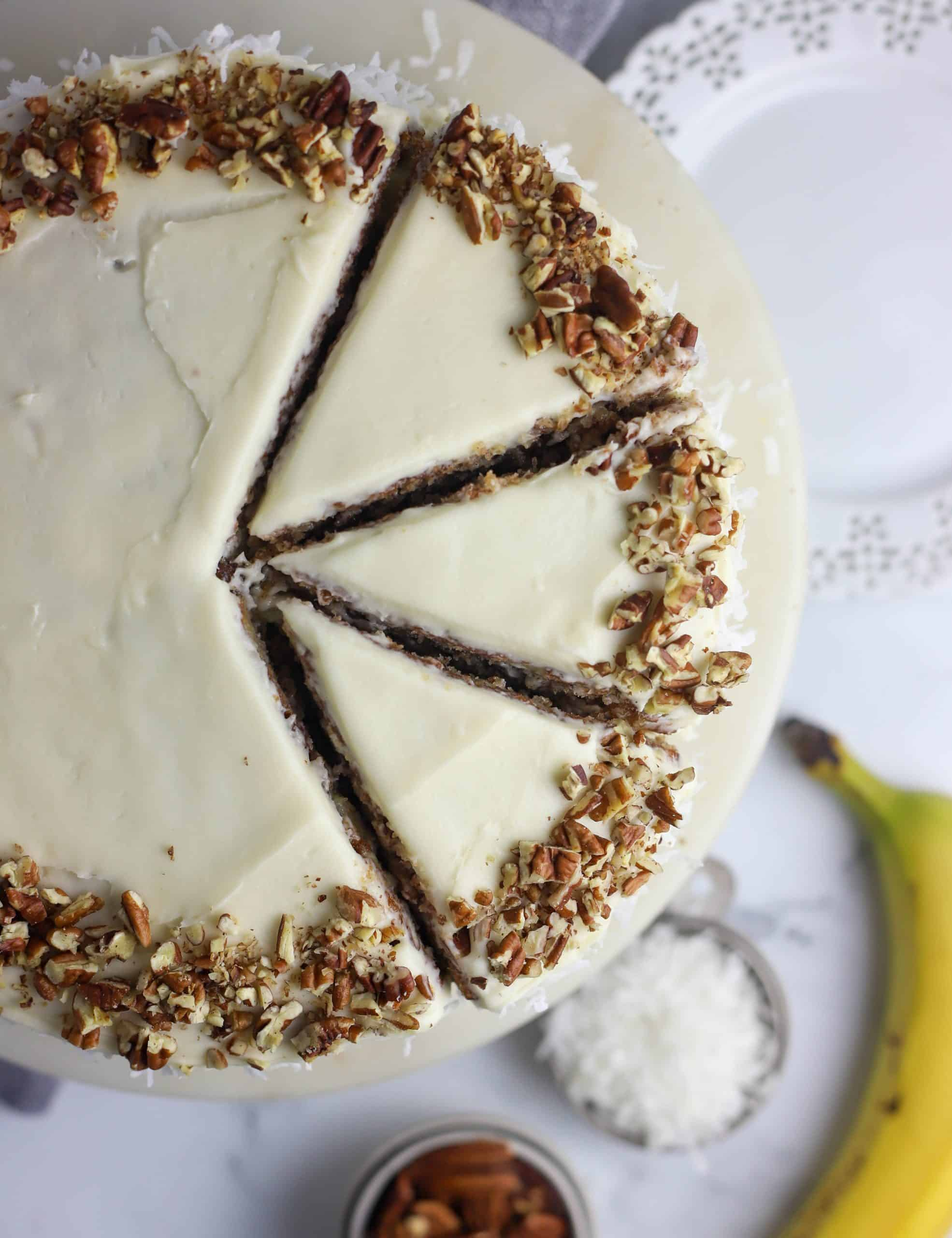top down view of hummingbird cake with three slices cut