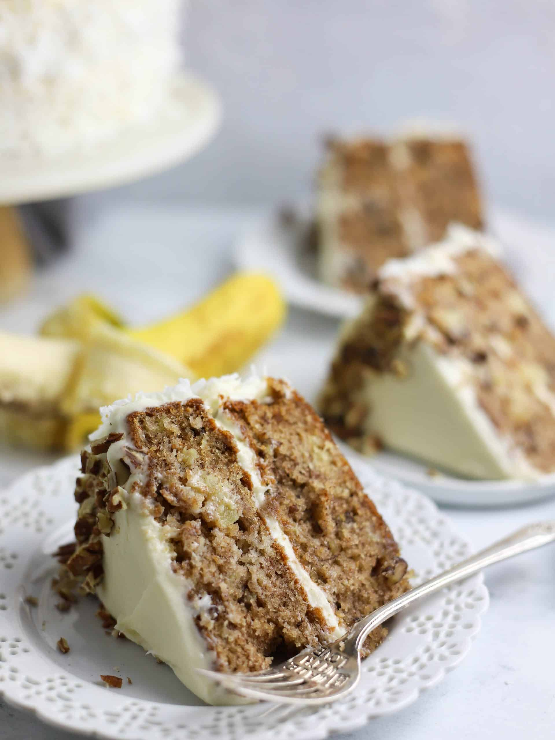 slice of hummingbird cake on a plate with a fork