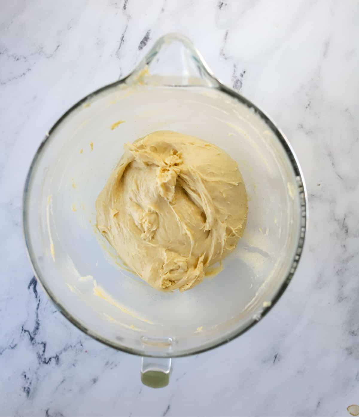 bowl of babka dough that's risen
