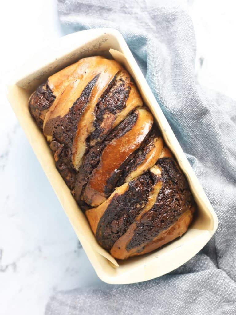 sourdough chocolate babka in a loaf pan